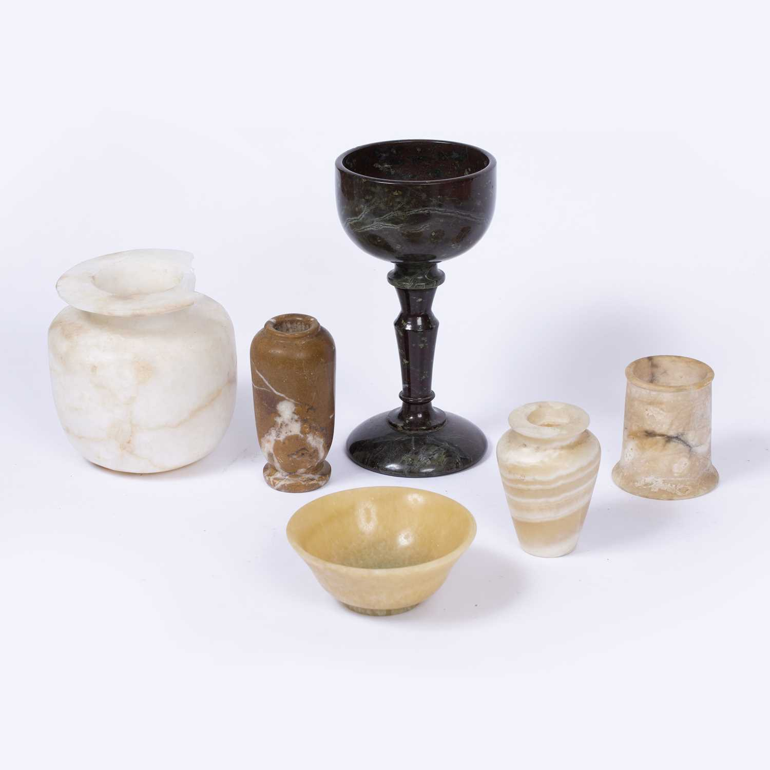 A variegated marble goblet with tapering stem, 21.5cm high; a translucent hardstone bowl, 12cm;