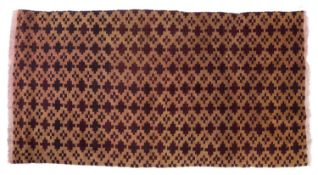 A Tibetan camel ground rug with a deep red continuing star motif, 162 x 85cm