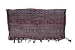 A large Turkoman style camel bag with banded polychrome decoration, with applied hooks, 133 x 71cm