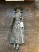 An old Spanish or Mexican metal model of a woman with articulated arm, 30cm high