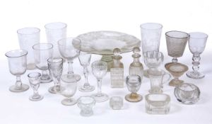 A 19th century green glass footed tazza, 27.5cm diameter; a pair of engraved glass beakers, 16cm;