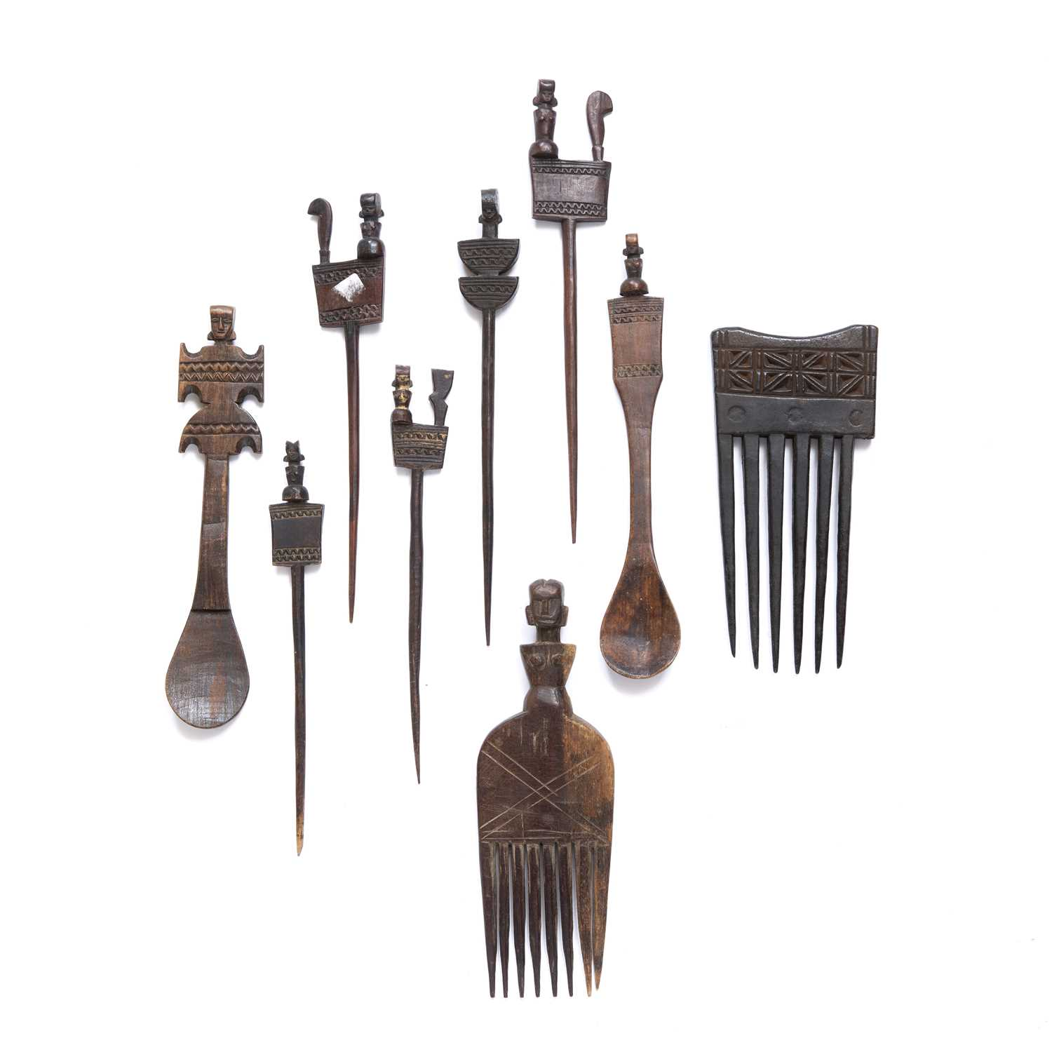 African Hemba hair combs and spoons, nine in total all carved wood, some with carved with figures to
