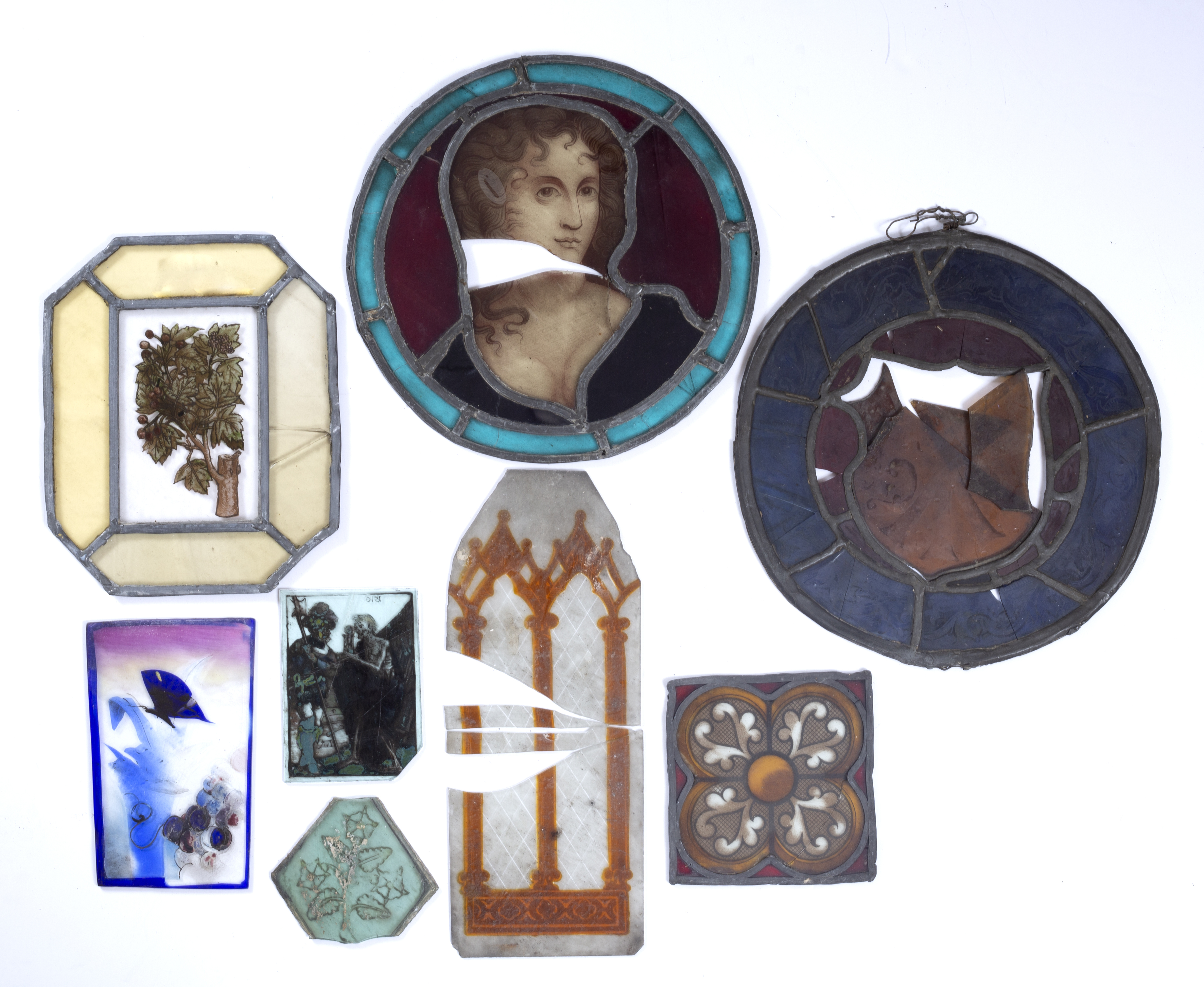 Fragments of six old stained and leaded glass windows, largest 26cm diameter