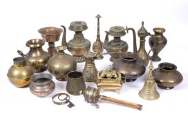 A collection of Middle and Far Eastern metalwork including prayer wheel, vases, coffee pot,