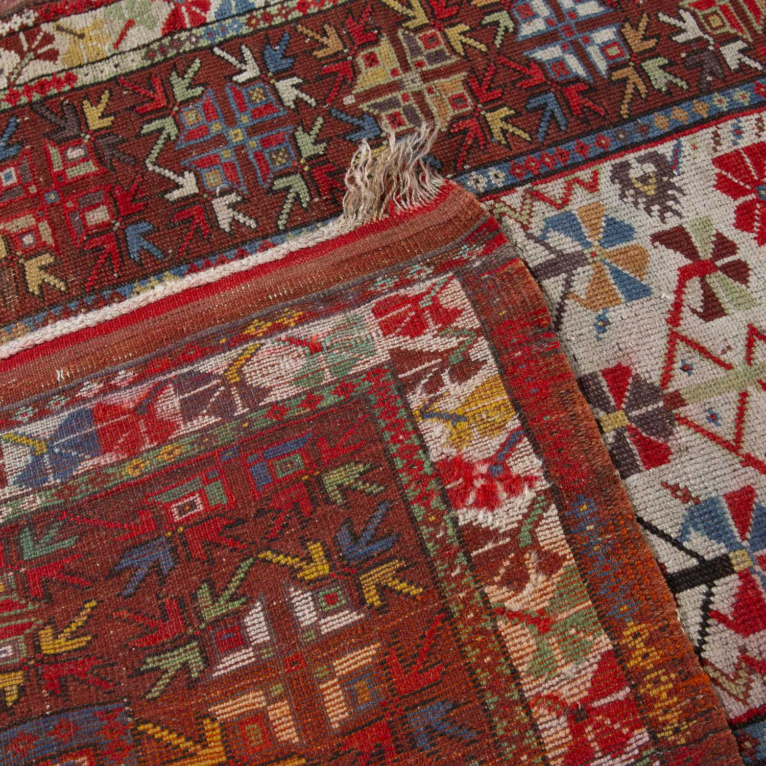 A Turkish Milas rug with a multi-coloured complex geometric design on a red and white ground, 120 - Image 2 of 2