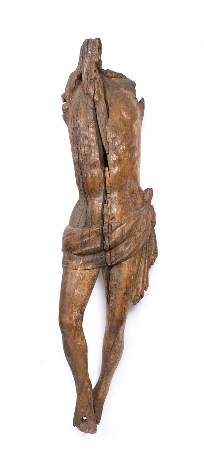 A carved wood Corpus Christi, perhaps Medieval French, of rustic torso form with loin cloth, 110cm