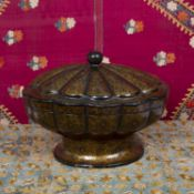 A Kashmiri papier mâché tureen and cover of fluted oval form with gilt lacquered ornament, 27cm