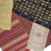 A Syrian textile panel with banded red and yellow decoration, 150 x 79cm; and a collection of four