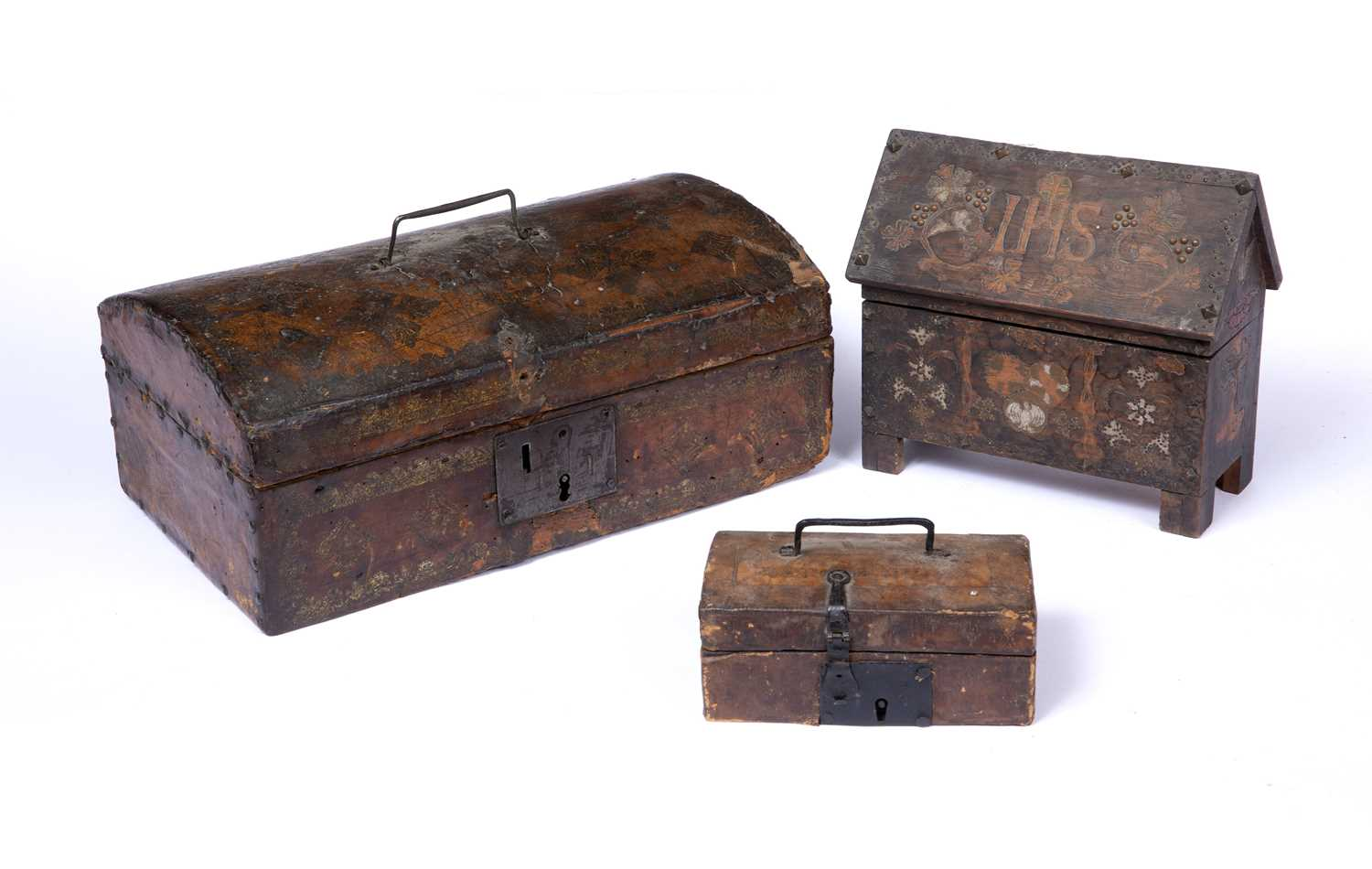 An 18th century leather covered domed top casket, 35cm wide containing a collection of candles, a - Image 2 of 4