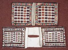 Two small Persian Shahsavan saddle bags with a simple hooked motif on a white ground, 67 x 21cm
