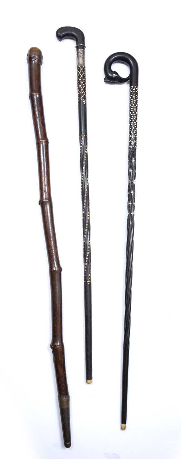 Two old Sri Lankan ebony and ivory inlaid walking sticks and a bamboo stick with brass mounts, - Image 3 of 3