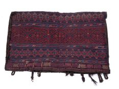A large Turkoman style camel bag with banded red and blue decoration and flat weave back, 125 x