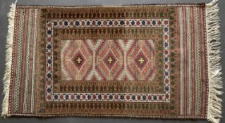 A Belouch mat with banded ends and triple diamond motif with white highlights, 149 x 85cm