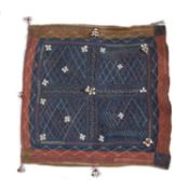 An Indian Banjara double sided camel bag with cowrie shell ornament and a design of four hatched