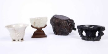 A Chinese jade carving of a butterfly on stand, 7.5cm; a blanc de chine libation cup with lotus leaf