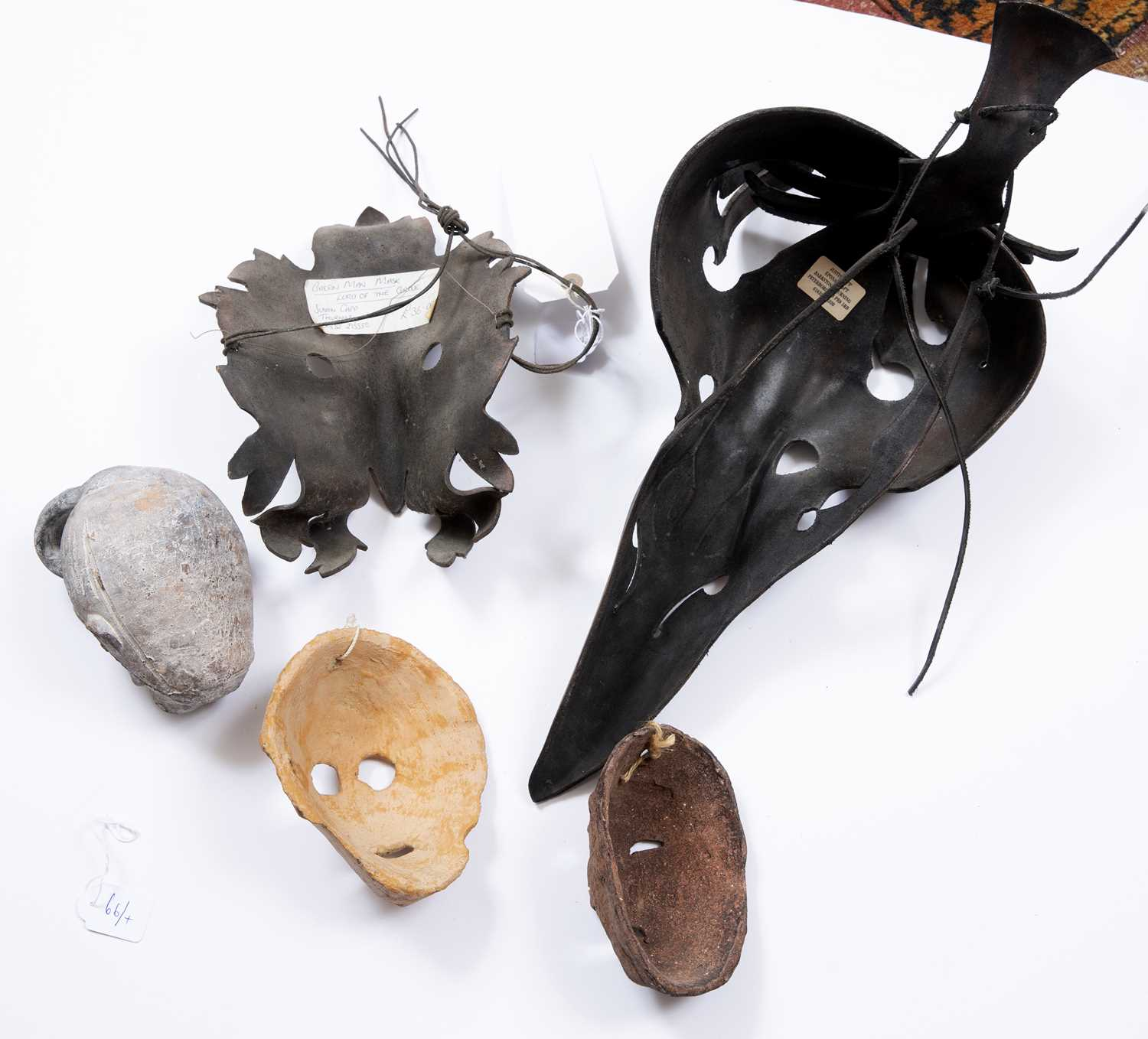 Capp, Justin - A leather 'Green Man' mask, another of horse like creature form, two pottery face - Image 2 of 2