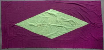 A Sumatran silk shawl with a central apple green medallion on a purple ground, 199 x 95cm
