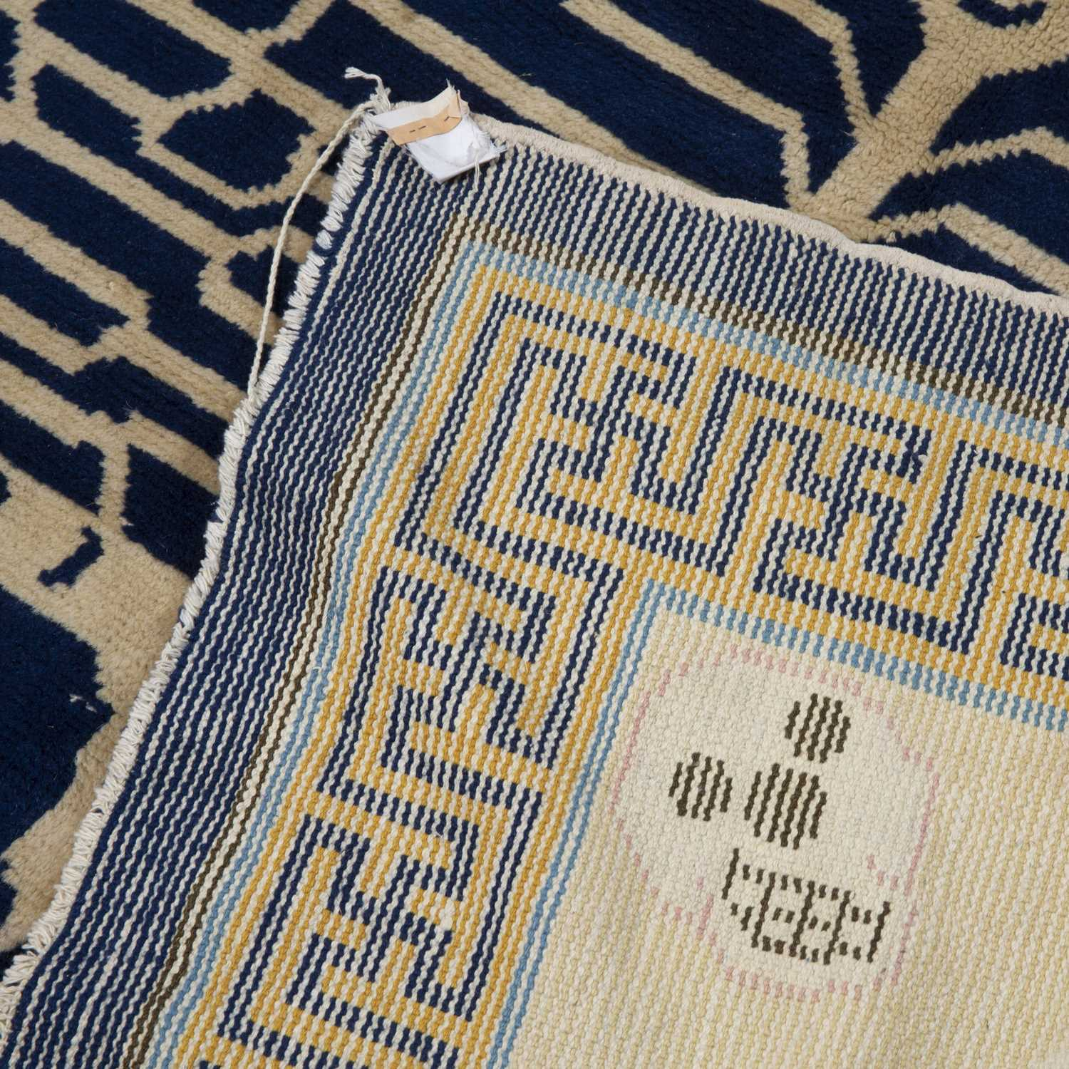 A Chinese blue and white ground rug decorated with two stylised tigers with mask surround and a - Image 2 of 2