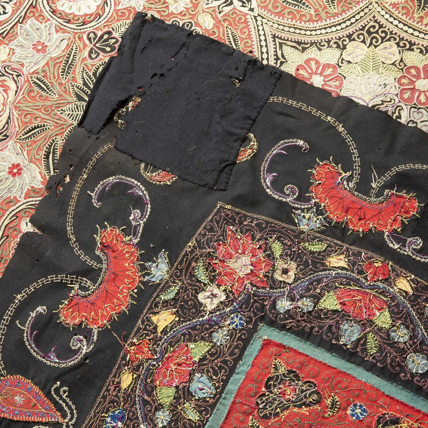 A 19th century Persian needlework table cover with an intricate scrolling design within a black - Image 2 of 2