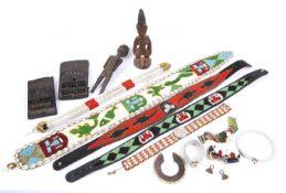 A mixed lot of tribal items including Yoruba ibeji figure, an African doll, two Tanzania thumb