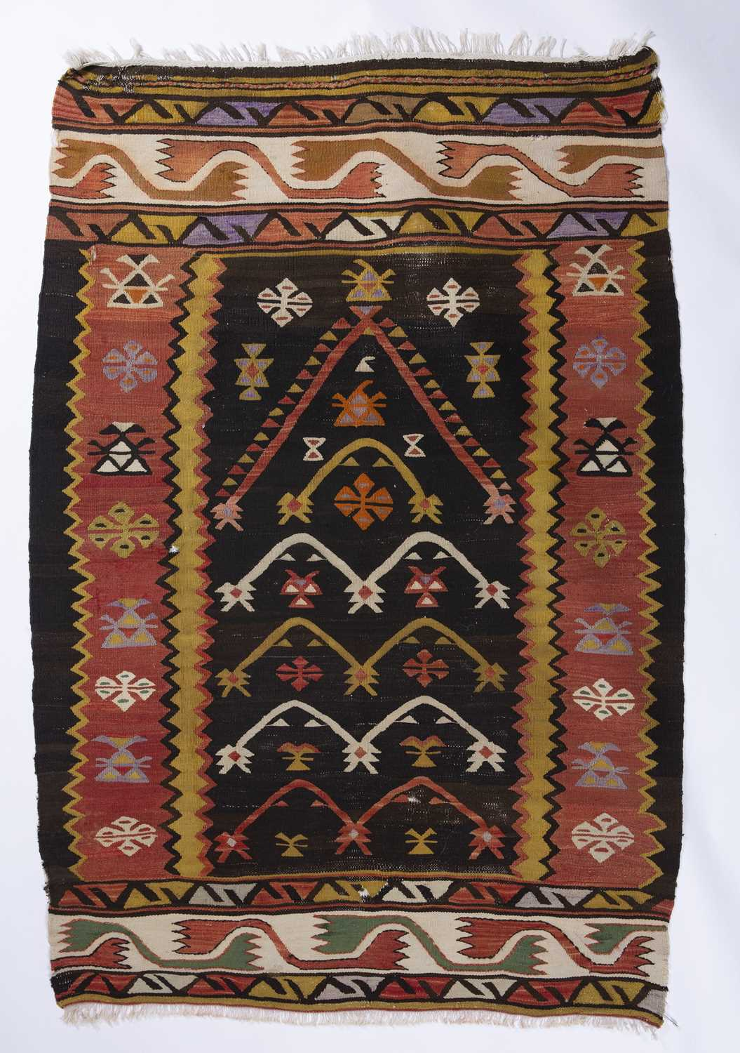 A Manastir Kelim with a simple polychrome foliate and geometric decoration with banded ends, 99 x