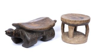 An African carved wooden stool in the form of a giant tortoise with incised decoration, 61cm long;