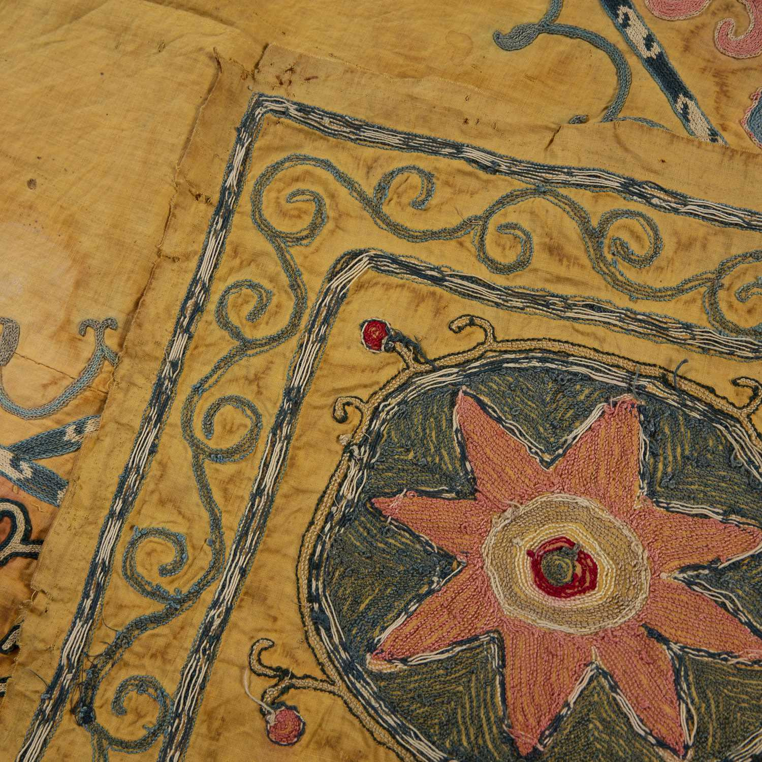 Part of an Uzbek Susani with a colourful star and scrolling design on a yellow ground, 142 x 90cm - Image 2 of 2