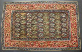 A 19th century Persian rectangular needlework table cover with a colourful repeating geometric and