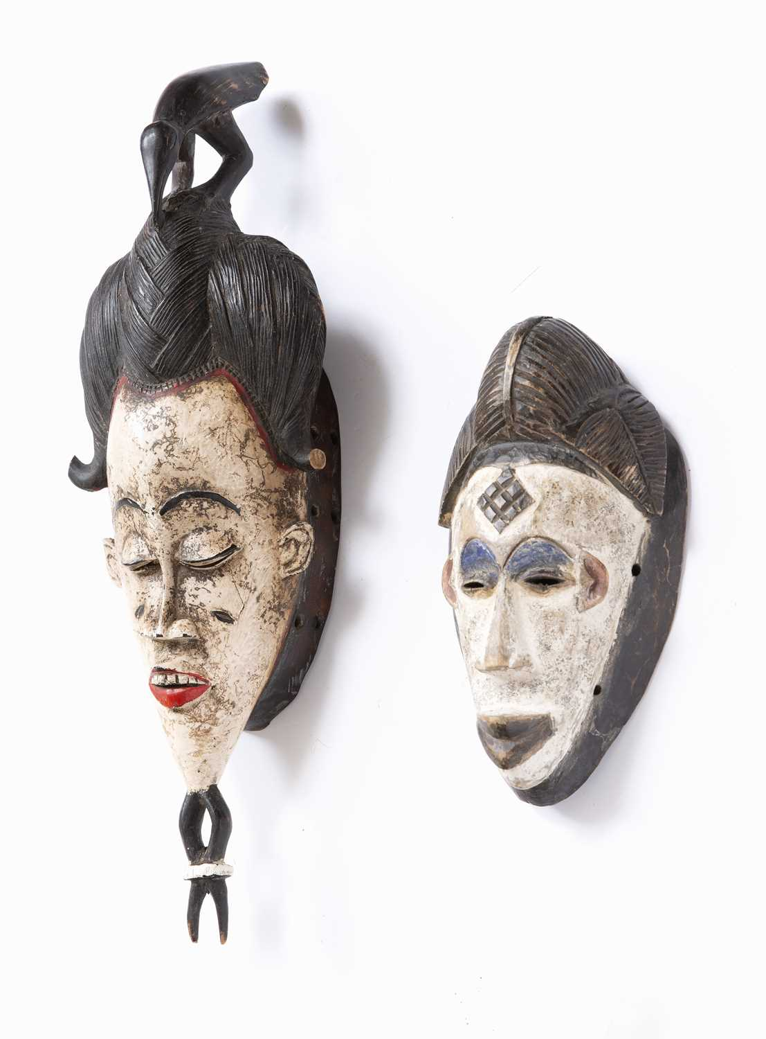 A Baule mask, Ivory Coast, carved wood with high incised coiffure topped by a bird with white and - Image 2 of 4