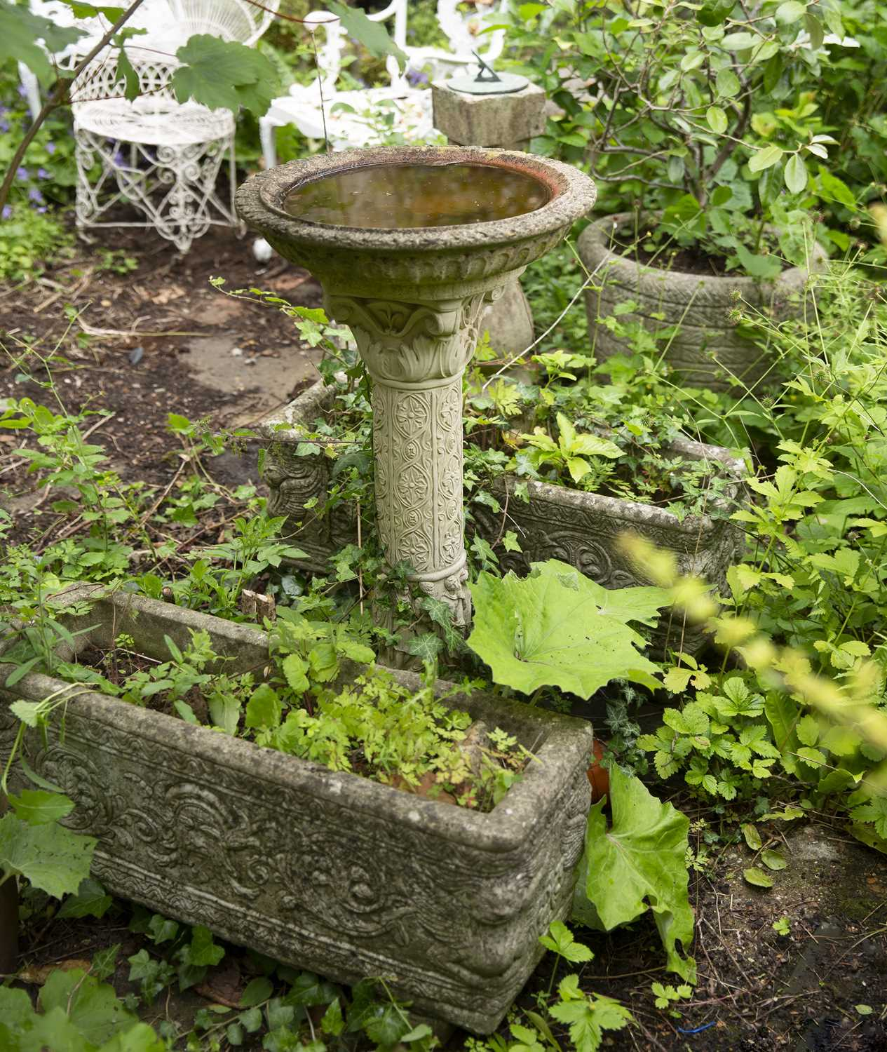 A sundial, on reconstituted stone baluster stand, 71cm high; together with a cherub and scallop bird - Image 3 of 3