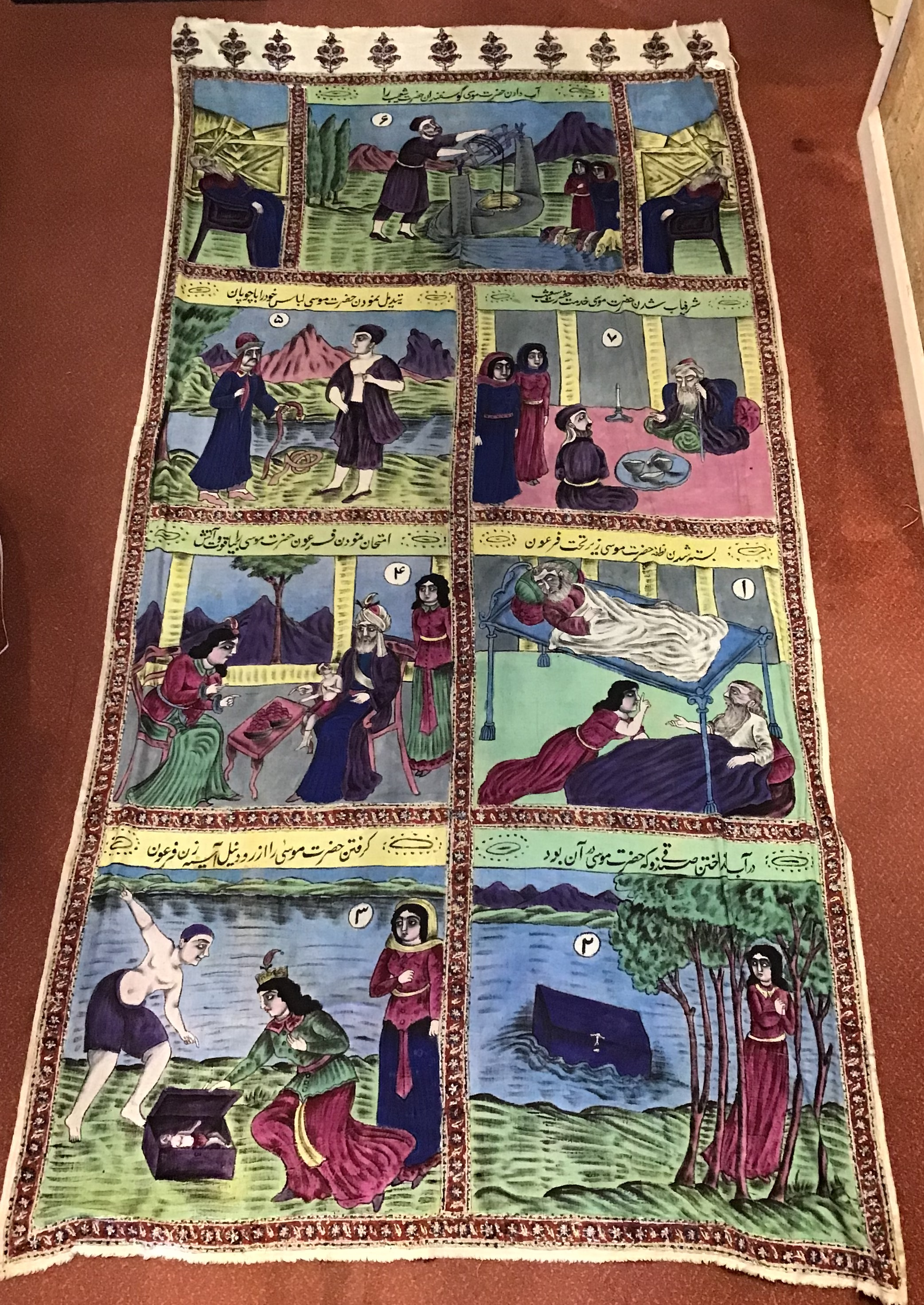 An Isfahan polychrome printed wall hanging depicting scenes from a traditional story in panel with