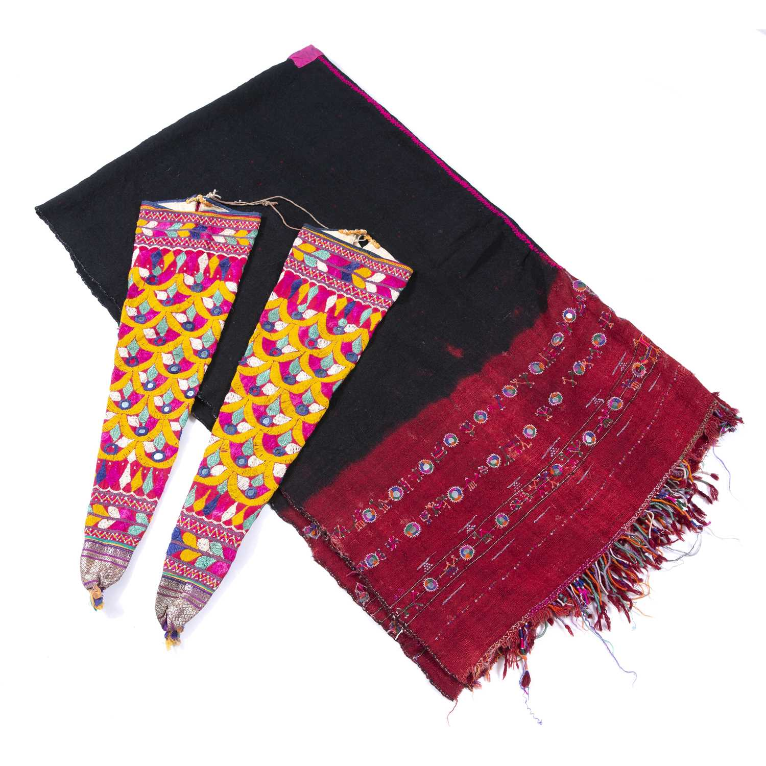A pair of Indian embroidered mirror work ceremonial horn covers together with a handwoven