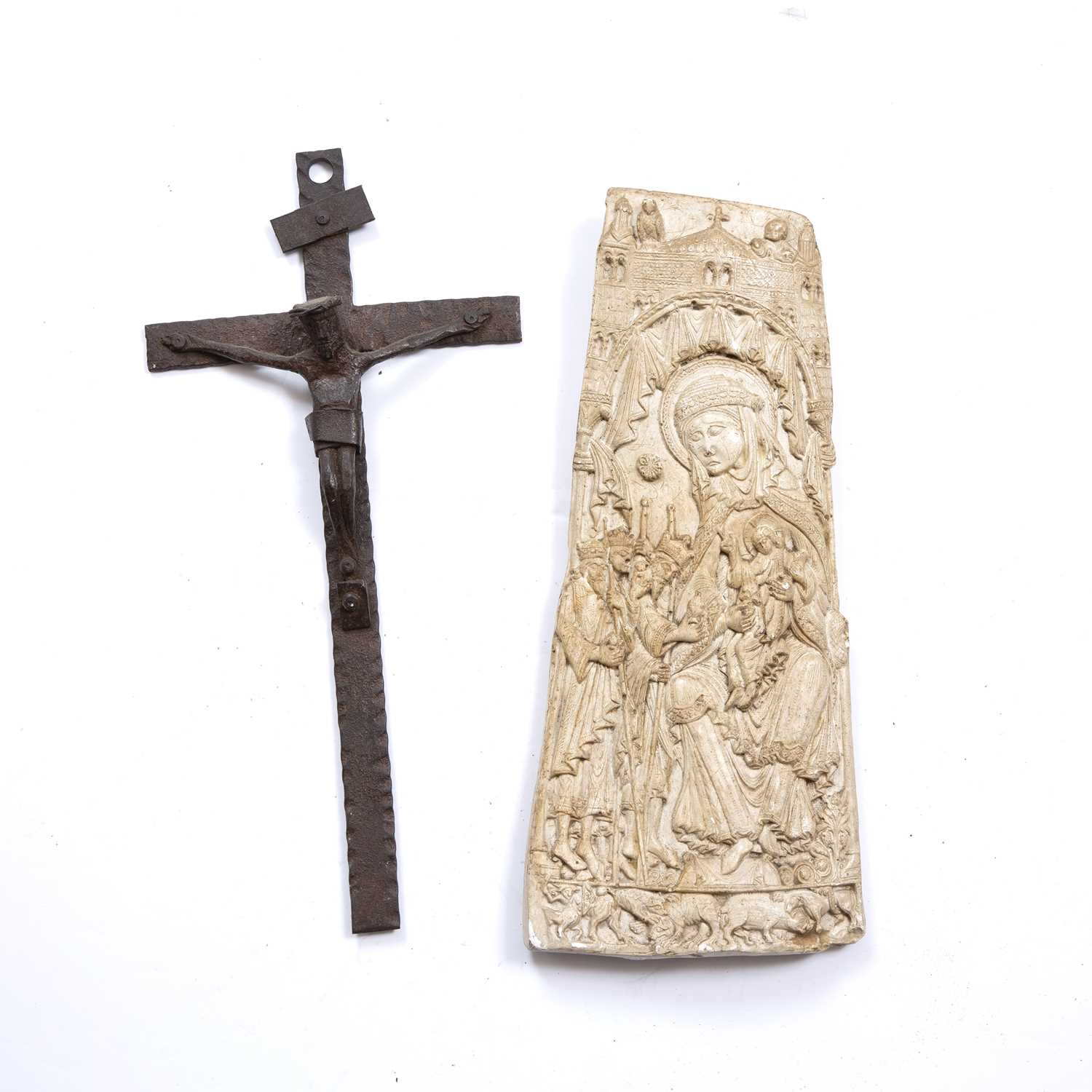 An old naive iron crucifix, 38cm and a plaster plaque portraying the Holy Mother and Child with