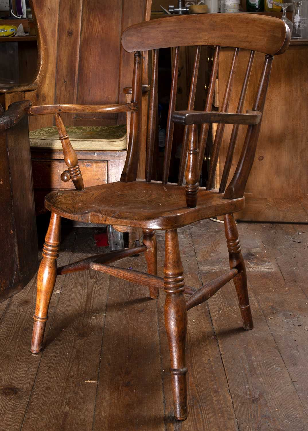 A 19th century beech and elm kitchen armchair with stick back and solid seat, on turned legs with ' - Image 3 of 5
