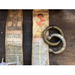 Two Ethiopian healing scrolls, on parchment decorated with saints and talismanic symbols together