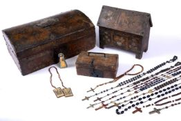 An 18th century leather covered domed top casket, 35cm wide containing a collection of candles, a