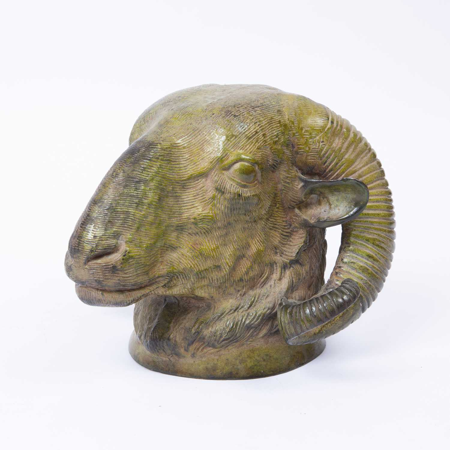 A 19th century bronze ram's head wall mount with green patina, 15cm high - Image 2 of 3