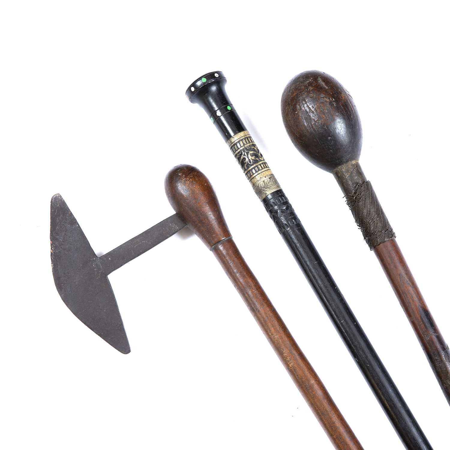 A South African Zulu knobkerrie, carved wood with metal wire grips together with an axe and a