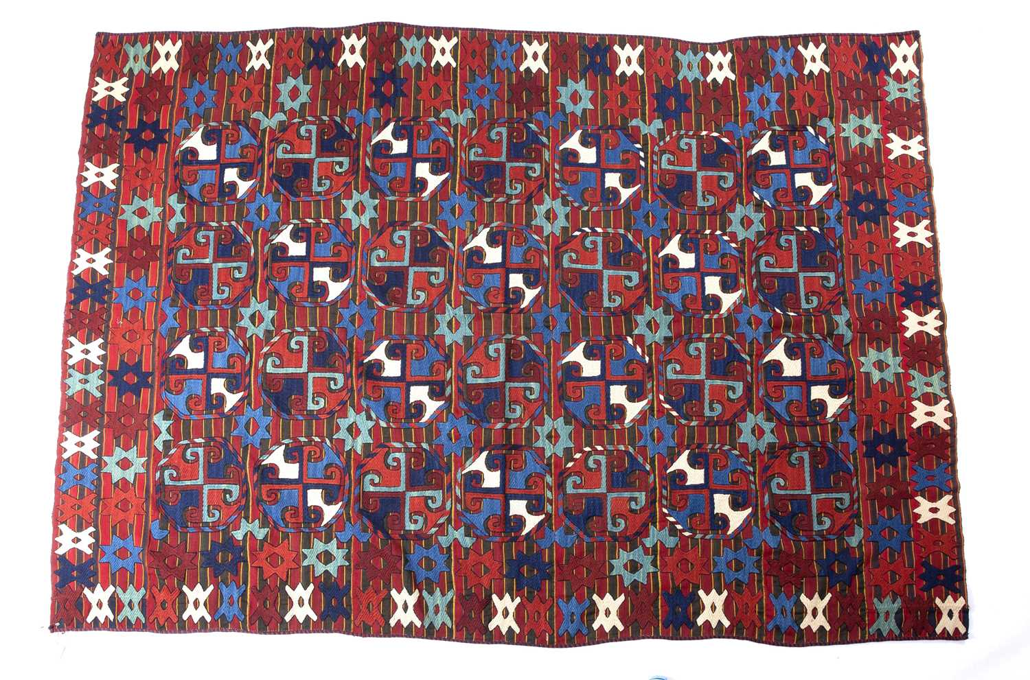 A Uzbek Lakai embroidered jajim with all over polychrome star motif on a banded ground, 254 x 177cm