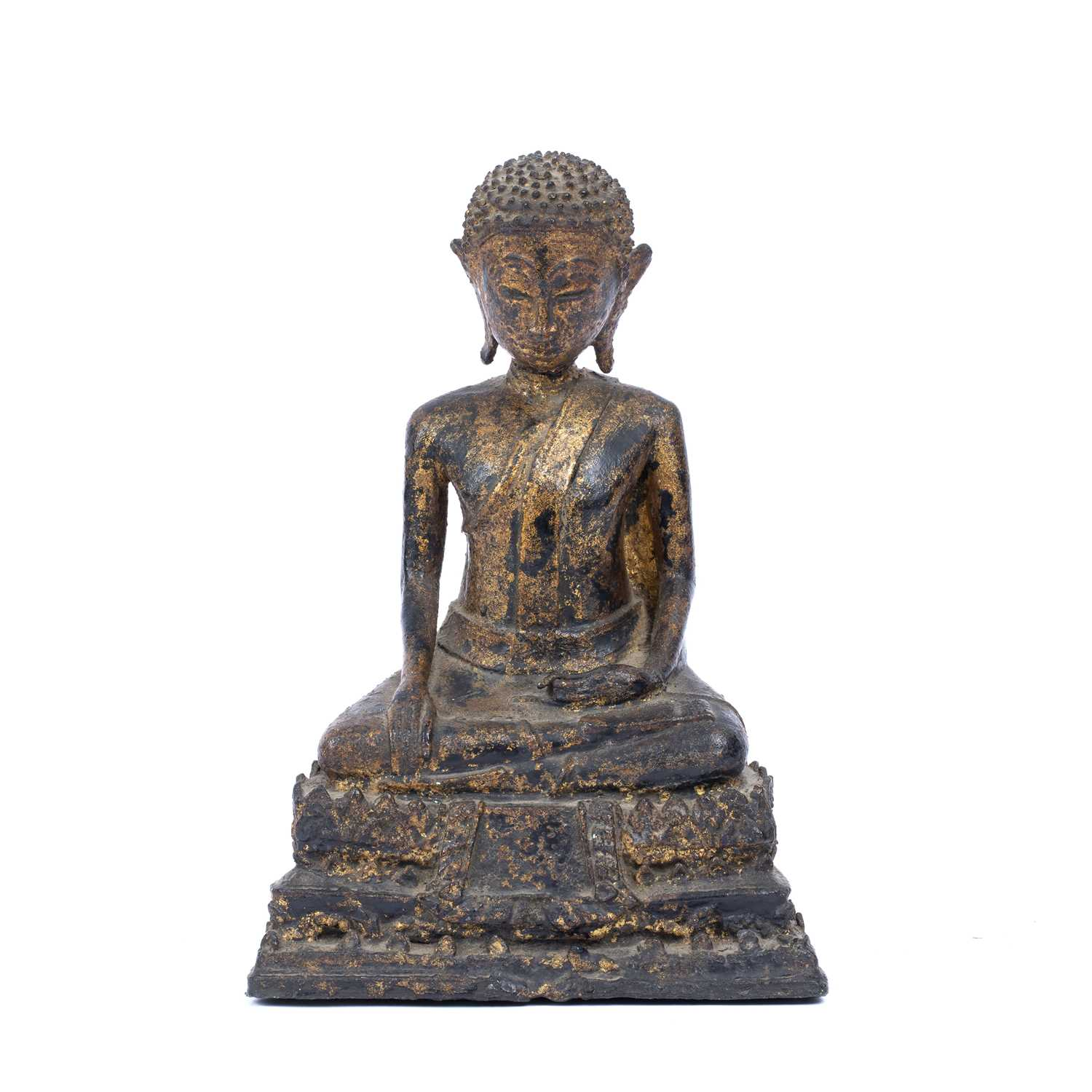 An antique Thai bronze seated Buddha, formerly gilded on an integral stepped base, 25.5cm high