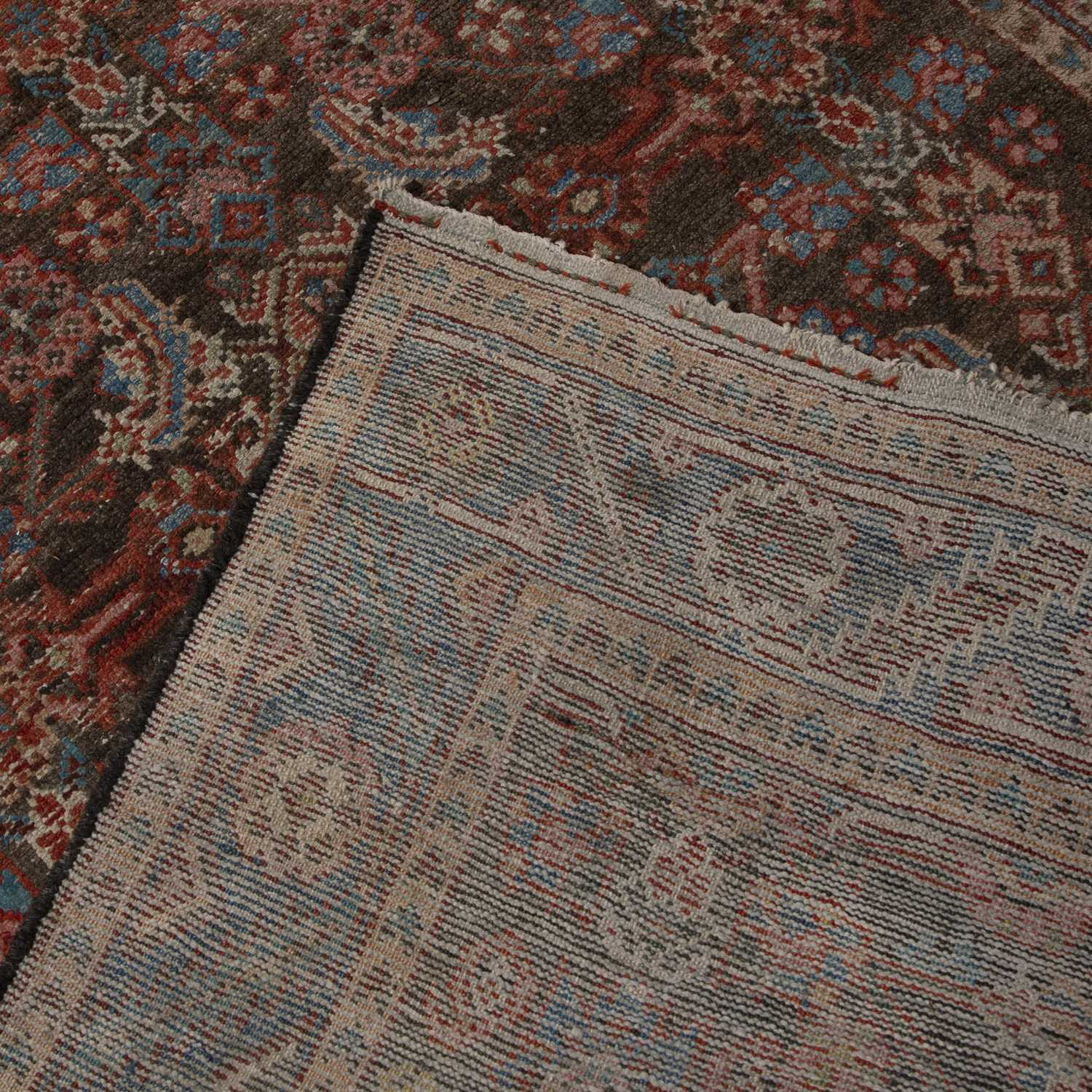 A Persian Bakshaish runner with a complex design of flowers and motifs within a triple border, 302 x - Image 2 of 2