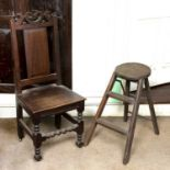 An 18th century oak side chair, the panelled back with scroll pierced top rail, having solid seat,