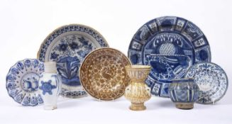 An 18th century Dutch Delft blue and white pottery deep bowl decorated a garden scene, 31cm; another