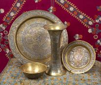 A group of four pieces of Egyptian Mamluk revival metalware to include a trumpet vase, 23cm high,