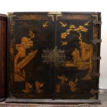 A George III black laquered and chinoiserie decorated cabinet, decorated with exotic birds and