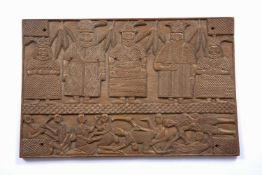 A Benin carved rectangular table top decorated five OBA figures and fighting men, 63 x 41cm