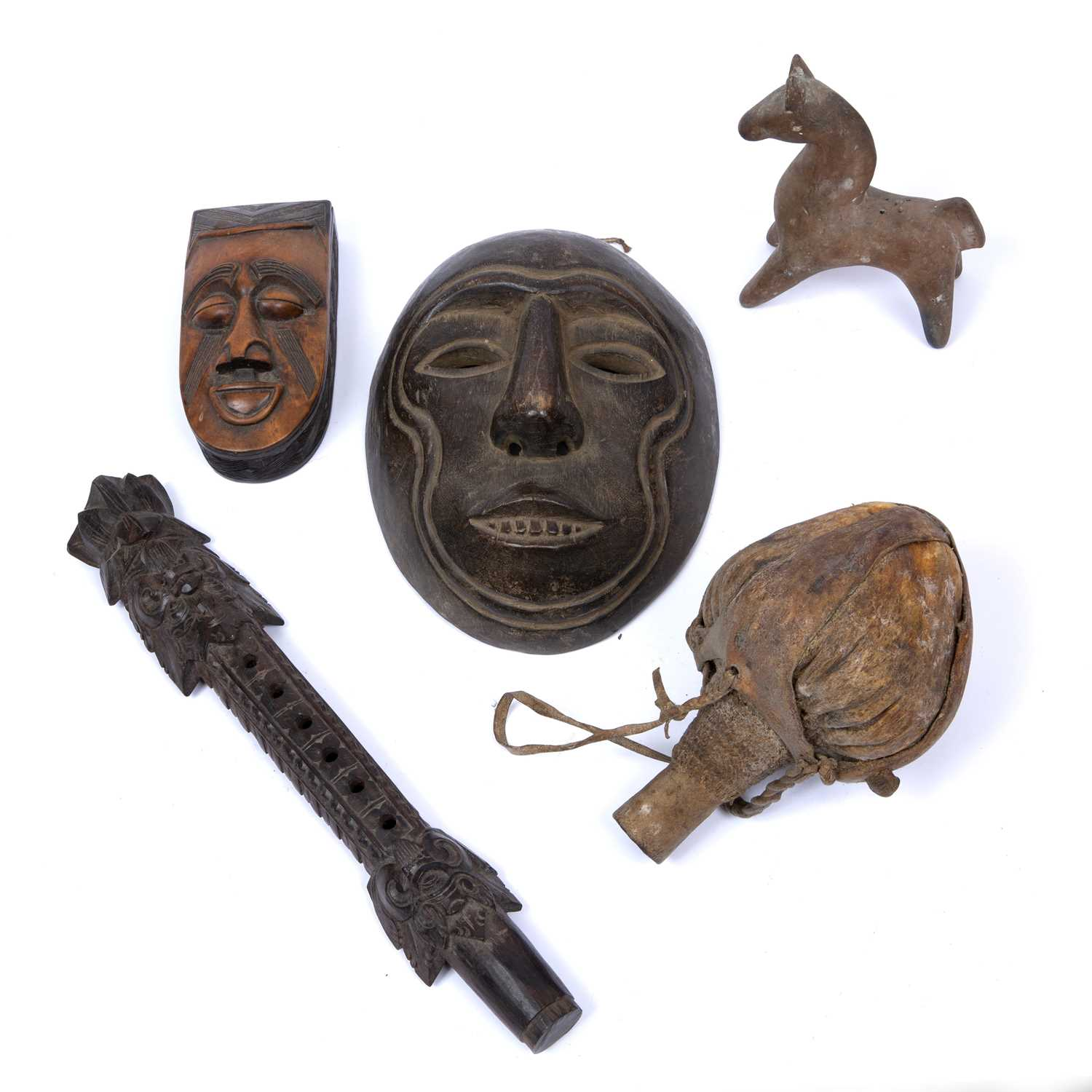 An eclectic collection of objects to include a tribal carved wooden mask box, 16cm, another mask,