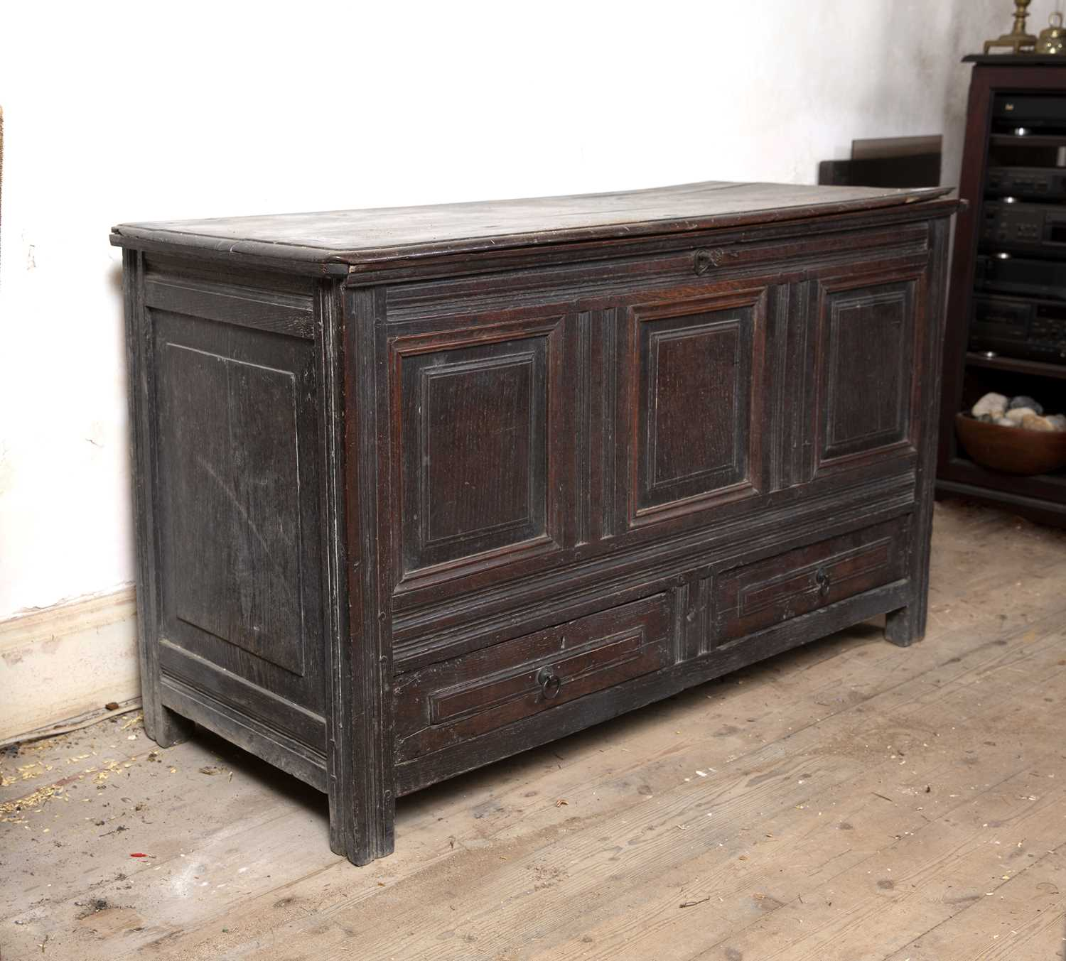 A late 17th Century oak coffer, with triple panelled front above two drawers, on block feet, 124cm