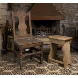 An 18th century oak side chair, the back with carved top rail and shaped splat, having solid seat,