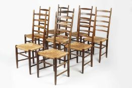 Arts & Crafts set of eight oak ladderback dining chairs with raffia seats, unmarked, 110cm high (8)